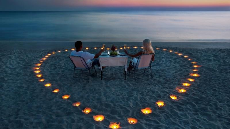 A Couple Enjoying a Sunset Dinner