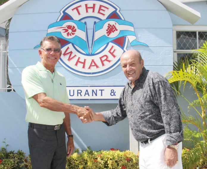 Clemens Guettler, right, shakes hands with Naul Bodden, one of the new owners of The Wharf. - PHOTO: JAMES WHITTAKER