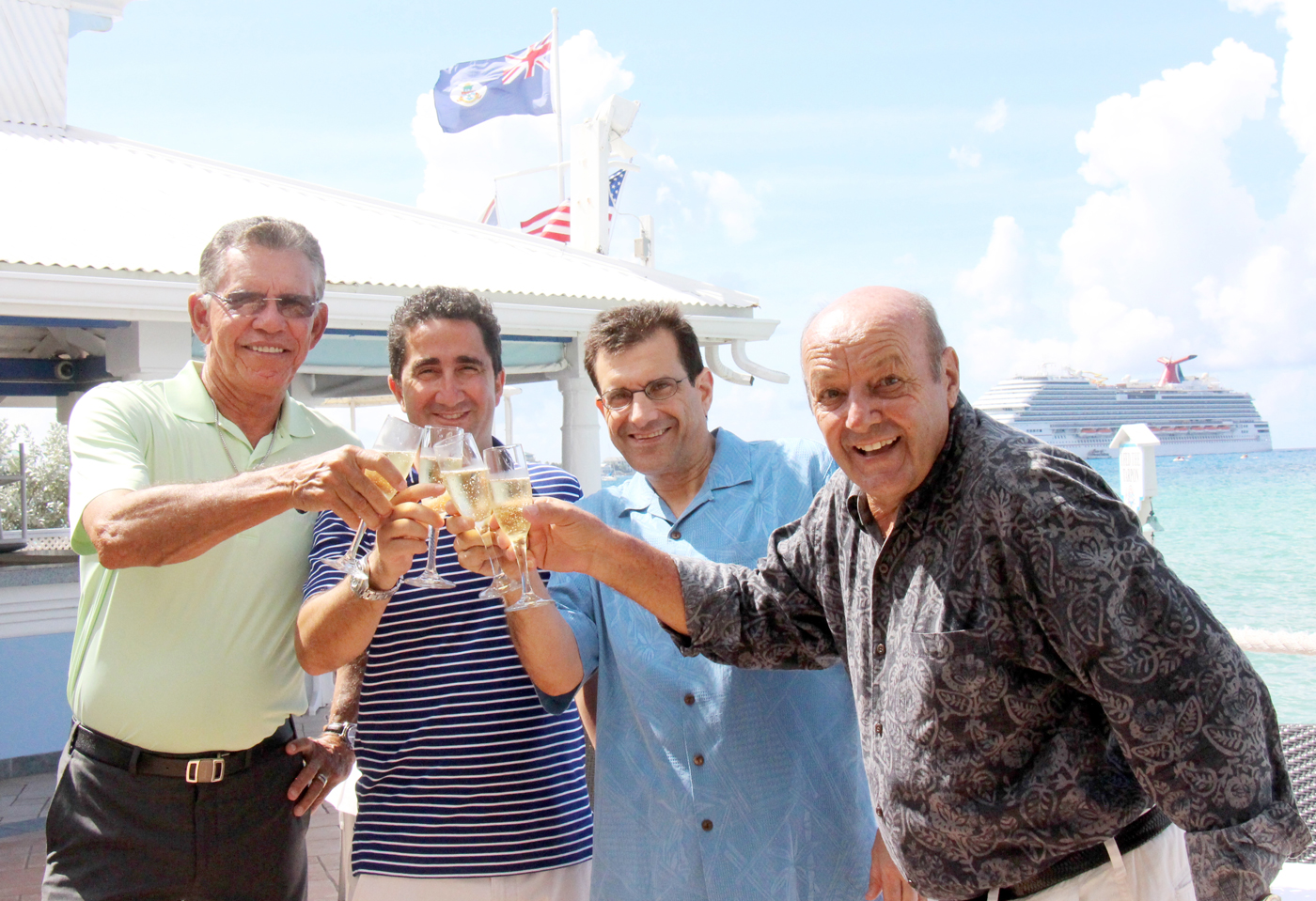 Naul Bodden, Luciano De Riso, Reno Mancini and Clemens Guettler toast the sale of The Wharf restaurant. – PHOTO: JAMES WHITTAKER